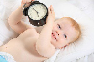 child with an alarm clock