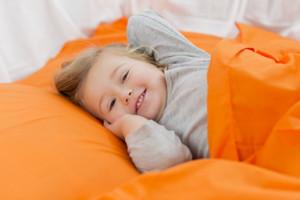 awake toddler  in bed