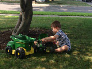 Playing trucks in his pj's.