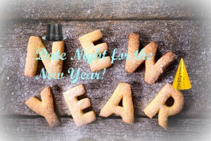 New Year text with cookies on the wooden background