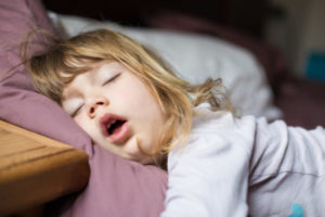 years old child,  sleeping on  king bed