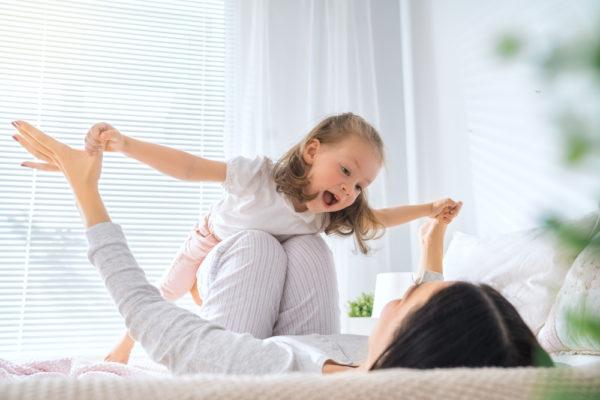 baby enjoying morning wake up routine with mother